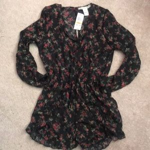 Small long sleeve romper with tags! Never worn.